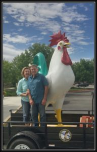 Galan and Nancy Merrill Standing with Large Chicken Mascot of Merrill Egg Farm