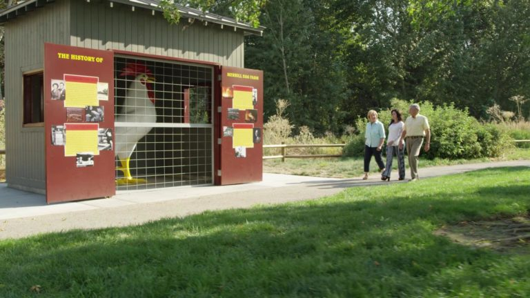 Alei walking along the Old Merrill Egg Farm outside Eagle in Merrill Park