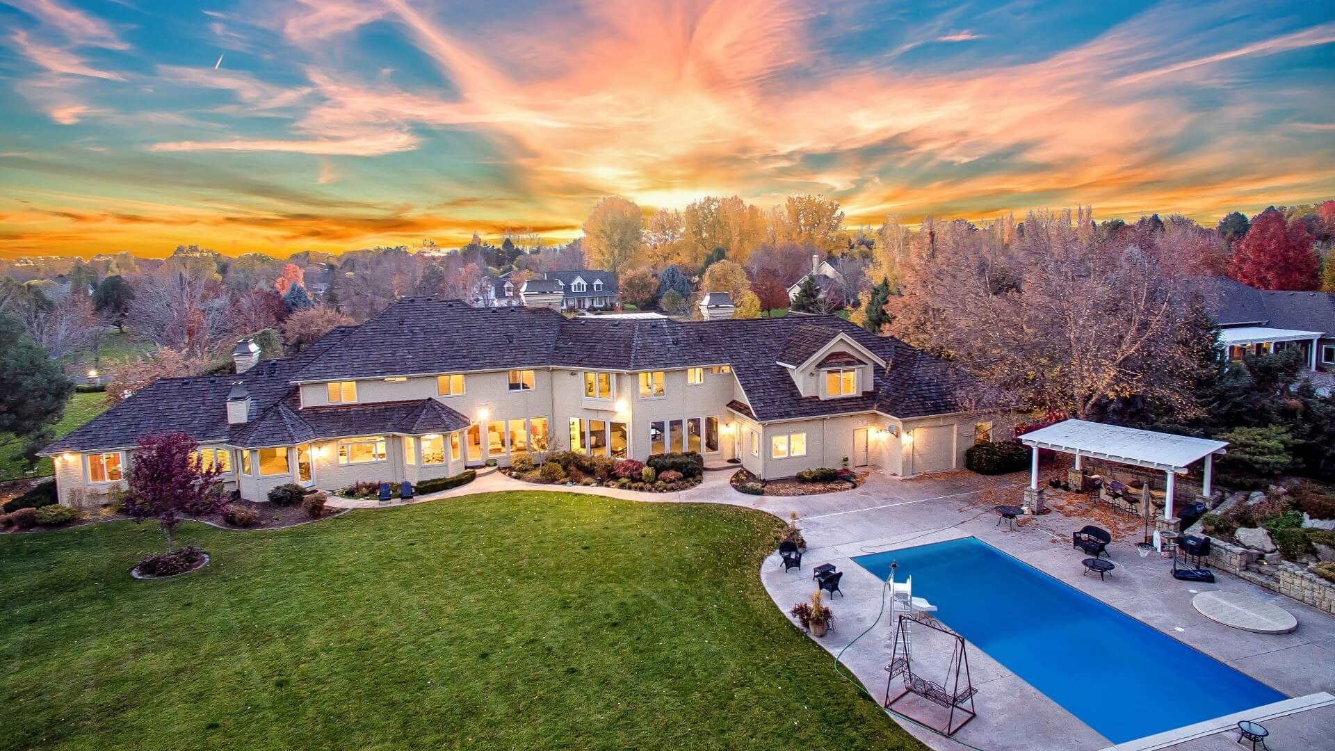 Gorgeous sunset over Estate Home on Ram Drive with large yard and pool