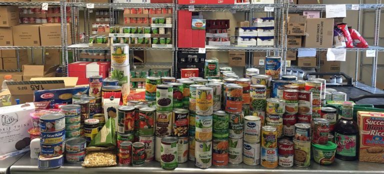 The Eagle Food Bank stocked shelf with cans