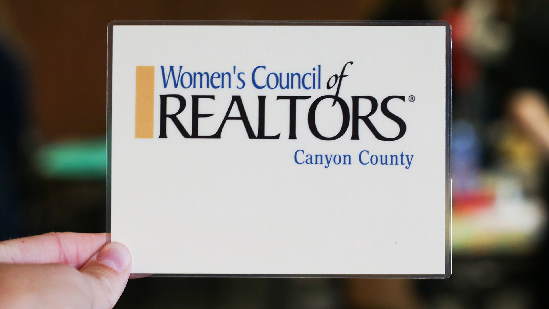 Women's Council of Realtors card held up with blurry background.jpg (1)