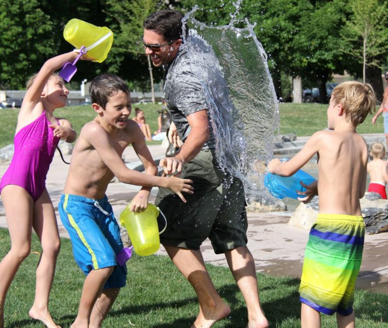 children playing at a park in eagle with a splash pad and water