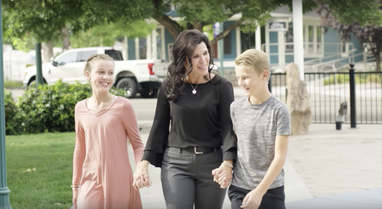 Alei Merrill and her children walking in Downtown Eagle