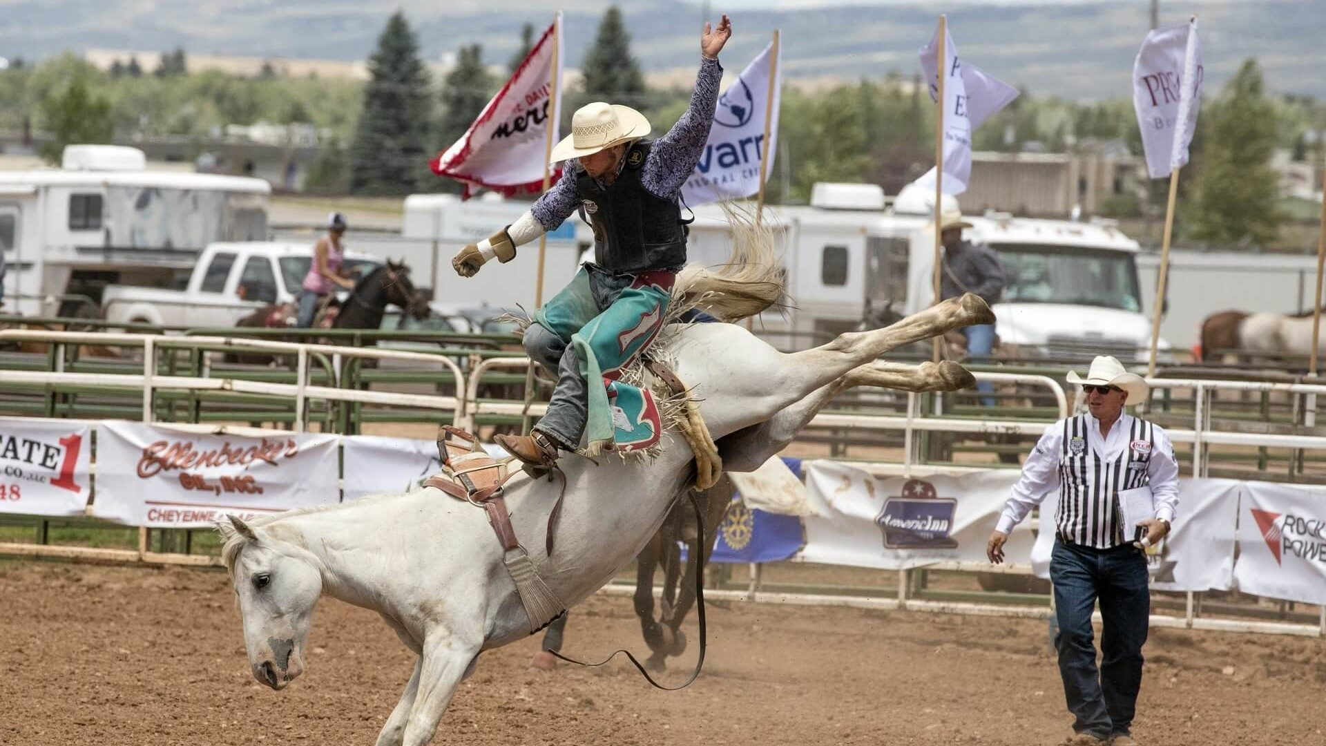 Cowboy Standing on a Bucking Bronco at the Eagle Rodeo