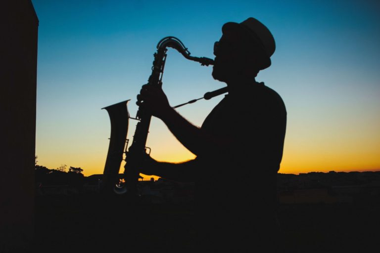 Eagle Blues Festival Man With Saxaphone Sunset